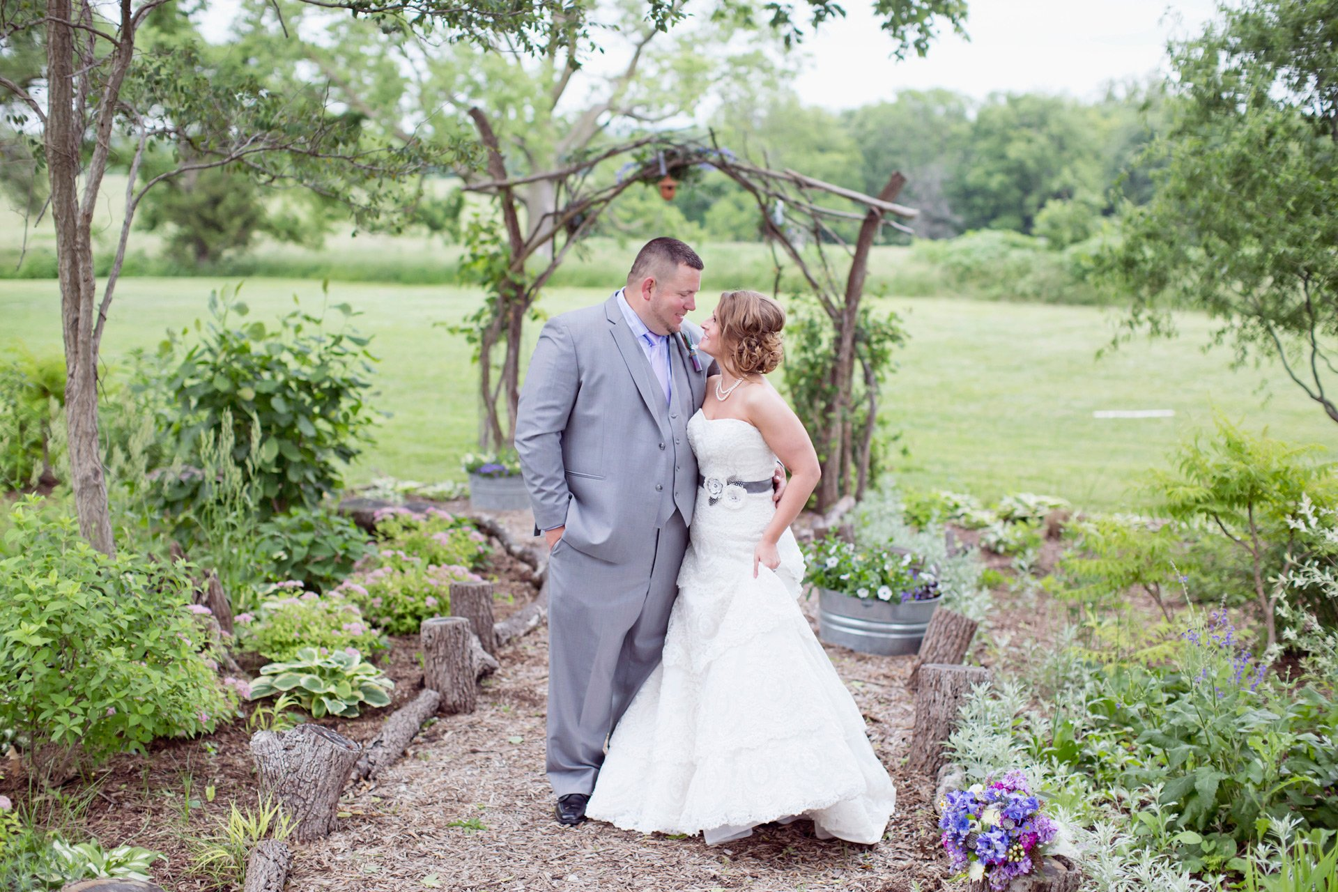 A bride and groom share a moment prior to their country barn wedding at Blue Bell Farm in Fayette, MO.