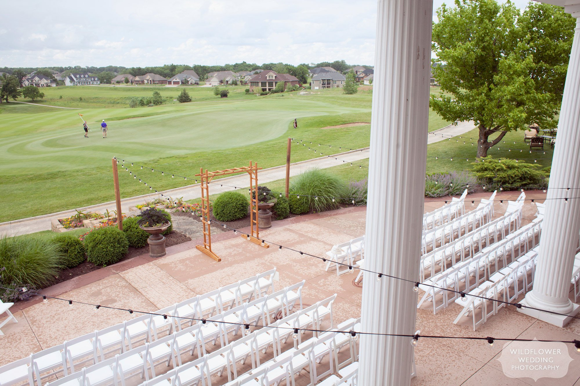 View of the outdoor patio for a wedding ceremony at the Old Hawthorne Country Club venue in Columbia, MO.