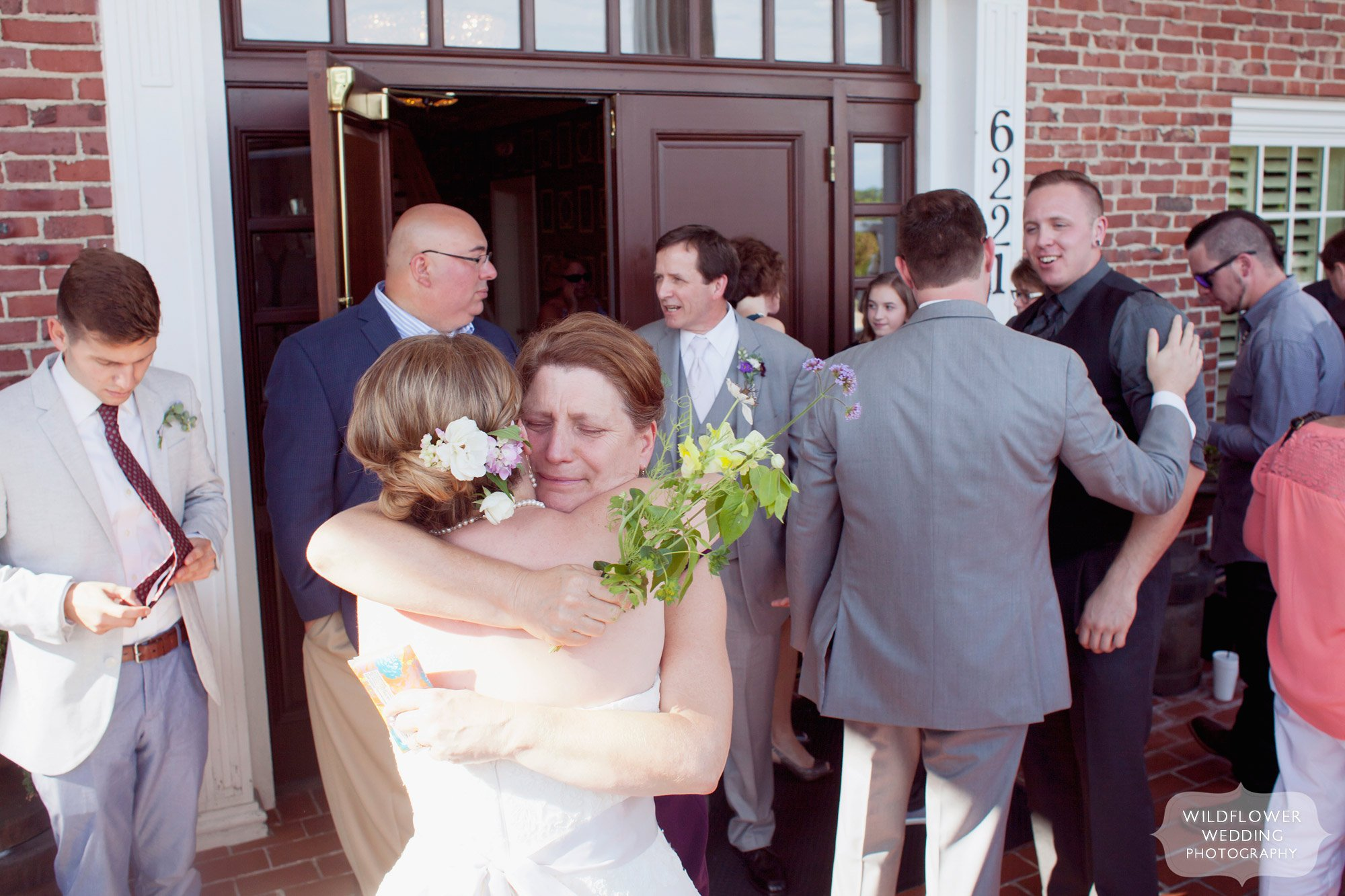 Mother of the bride emotionally hugs her daughter after the ceremony.