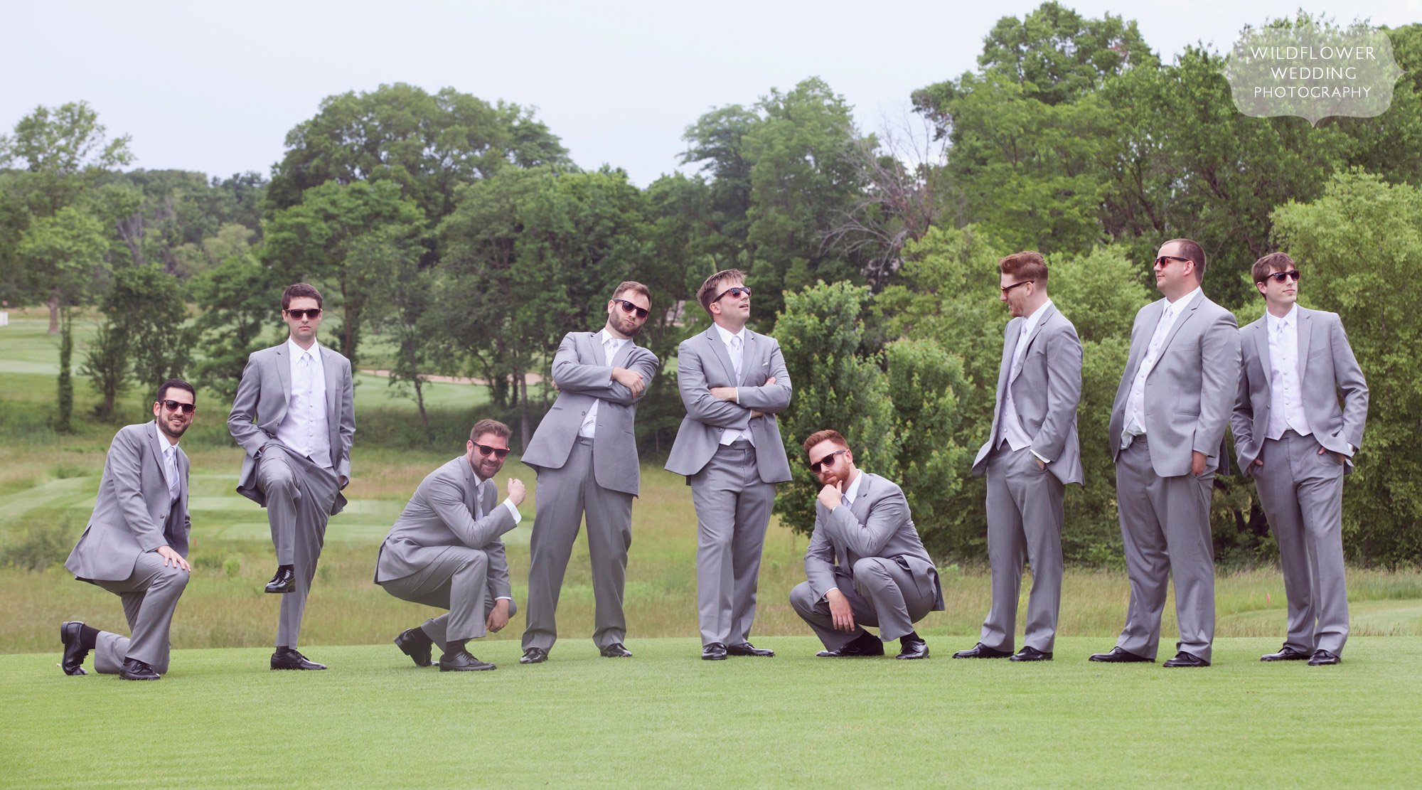 Funny wedding photo of eight groomsmen at the Old Hawthorne Club in Columbia, MO.