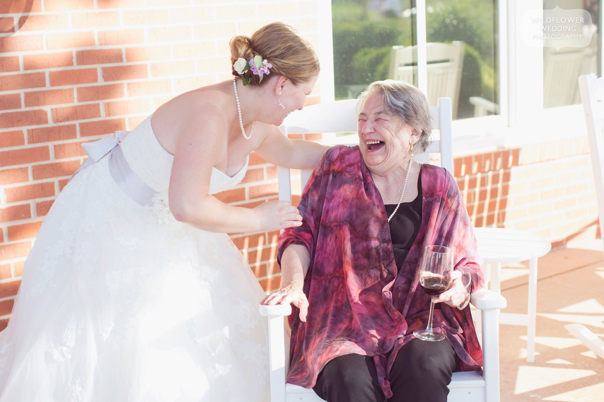 Great photojournalistic wedding photo of the bride with her grandmother at wedding in Columbia, MO.