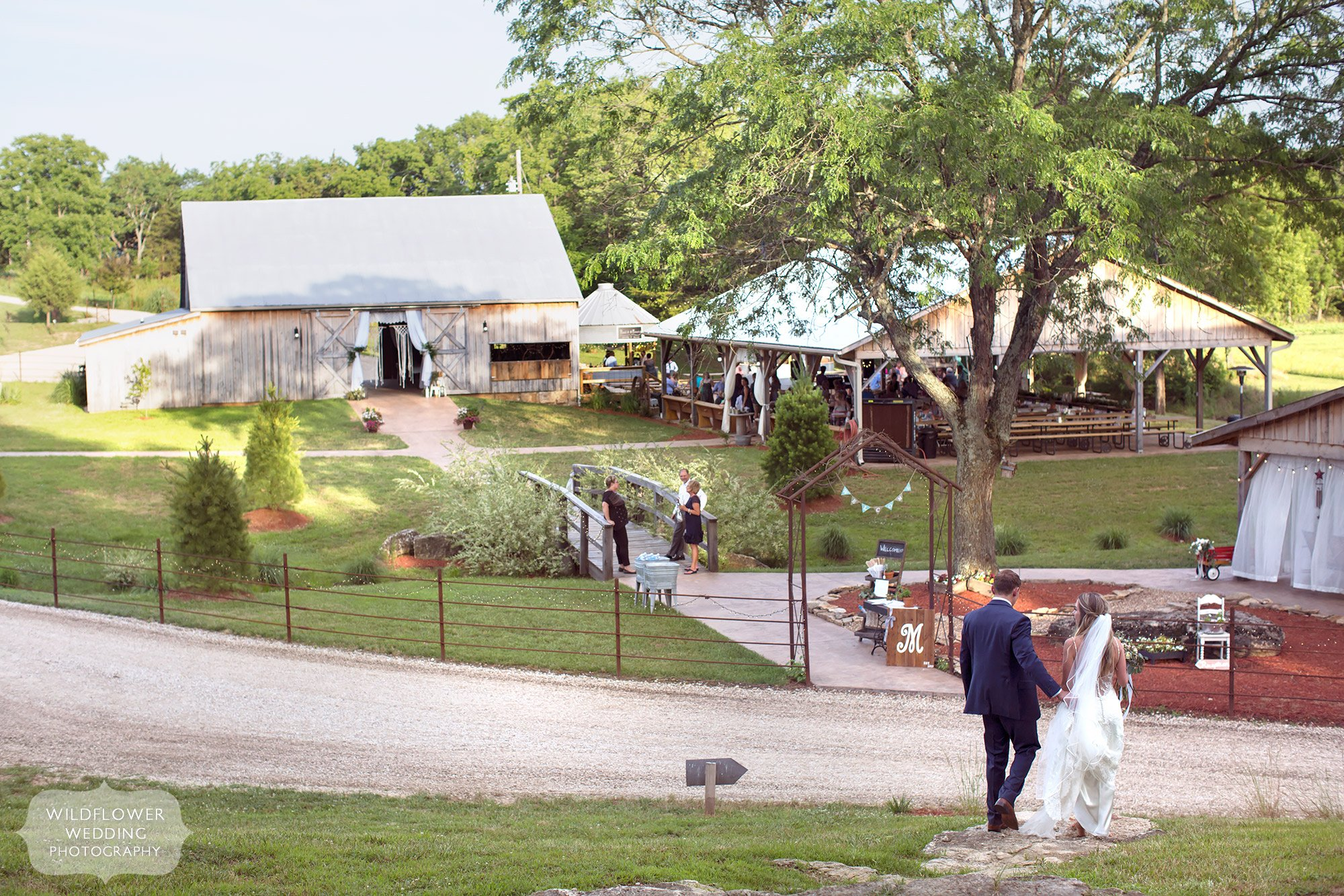 View of the country barn wedding venue with macrame and lace in southern MO.