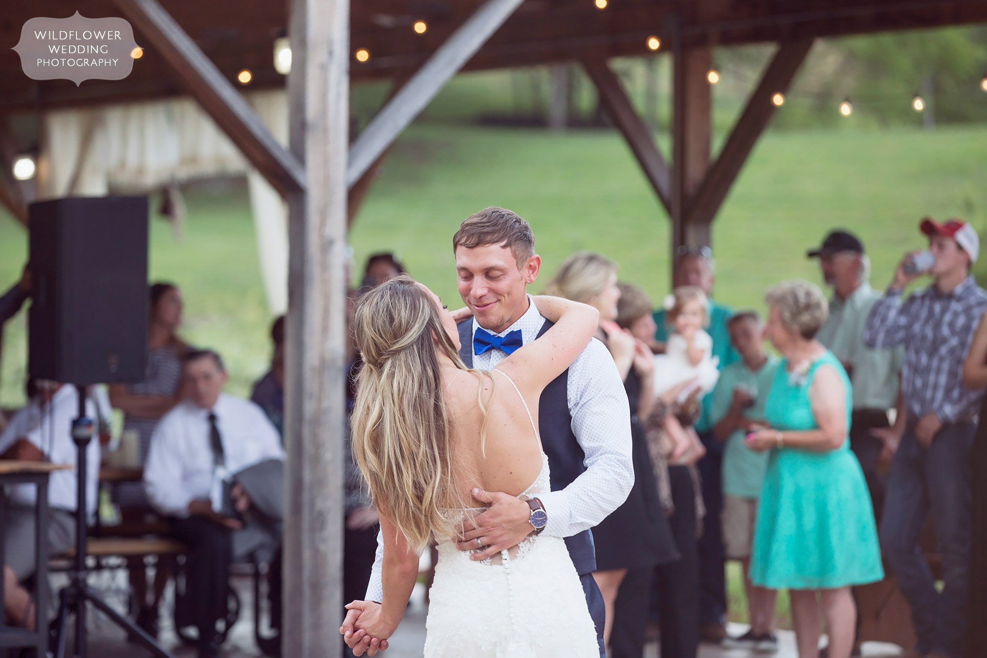 The bride and groom have a romantic first dance during their country barn wedding at the Kempker's Back 40 venue.
