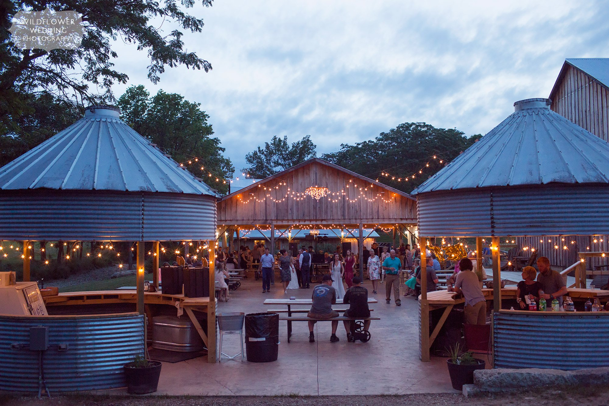 This Kempker's Back 40 Barn wedding in the country had the most beautiful outdoor dancing patio with string lights above and silos as outdoor bars for drinks.