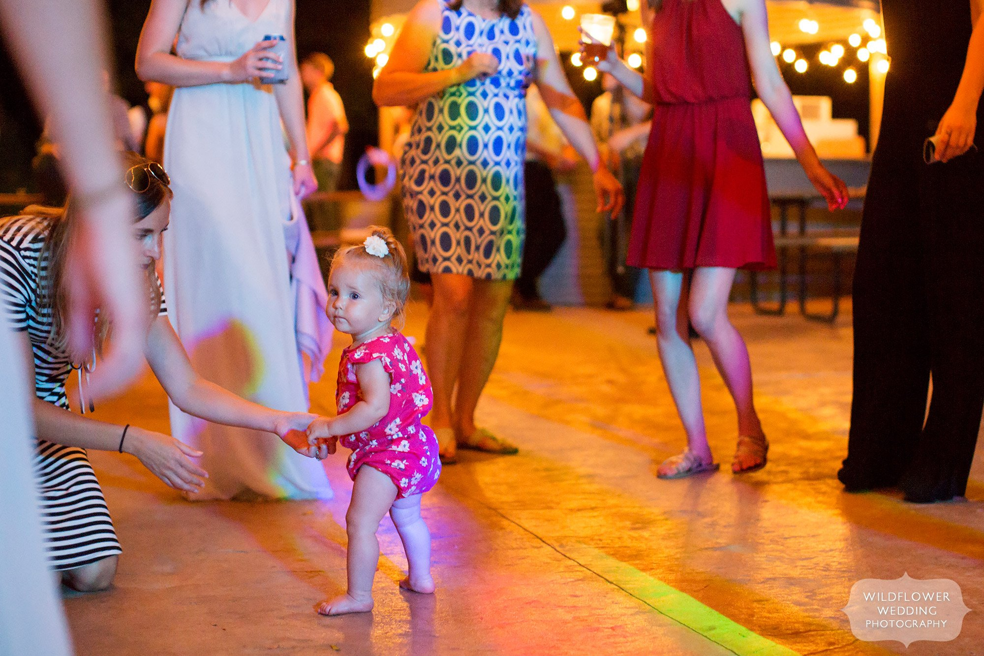 Funny photo of a little toddler girl on the dance floor at Kempker's Back 40 barn venue in southern MO.