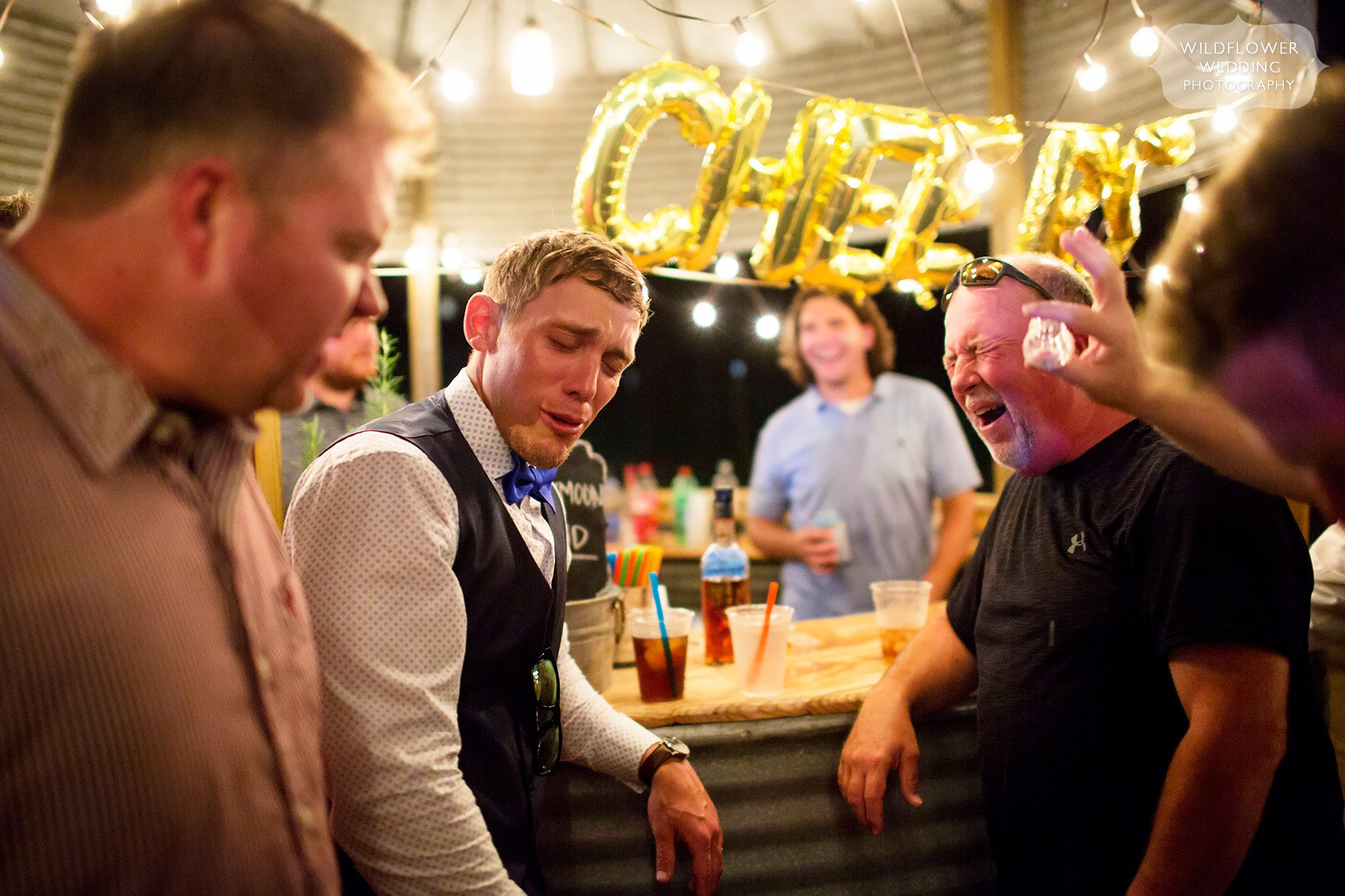 Hilarious photos of faces after doing alcohol shots at the silo bar at this country wedding in MO.