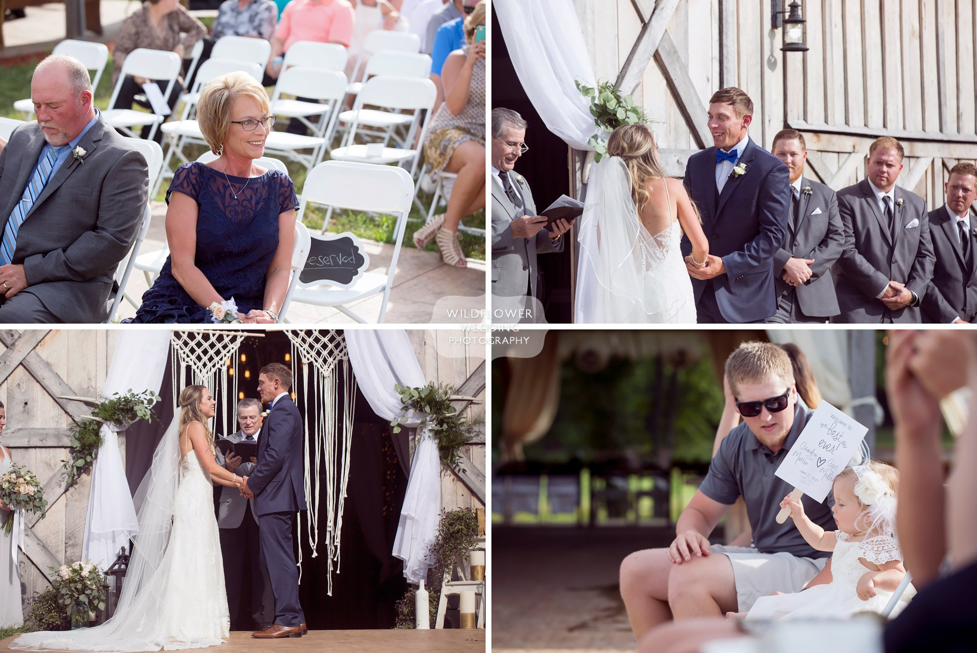 Documentary photos of the wedding ceremony guests watching the bride and groom at this barn wedding venue in MO.