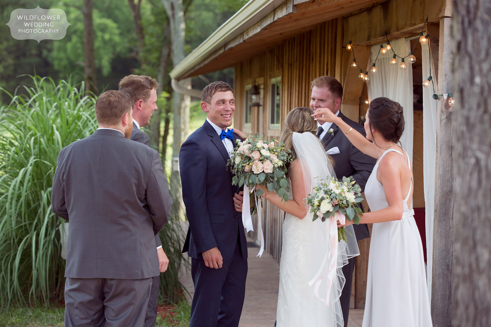 Such a happy photo of the bride and groom's friends congratulating them after the wedding ceremony at Kempker's.