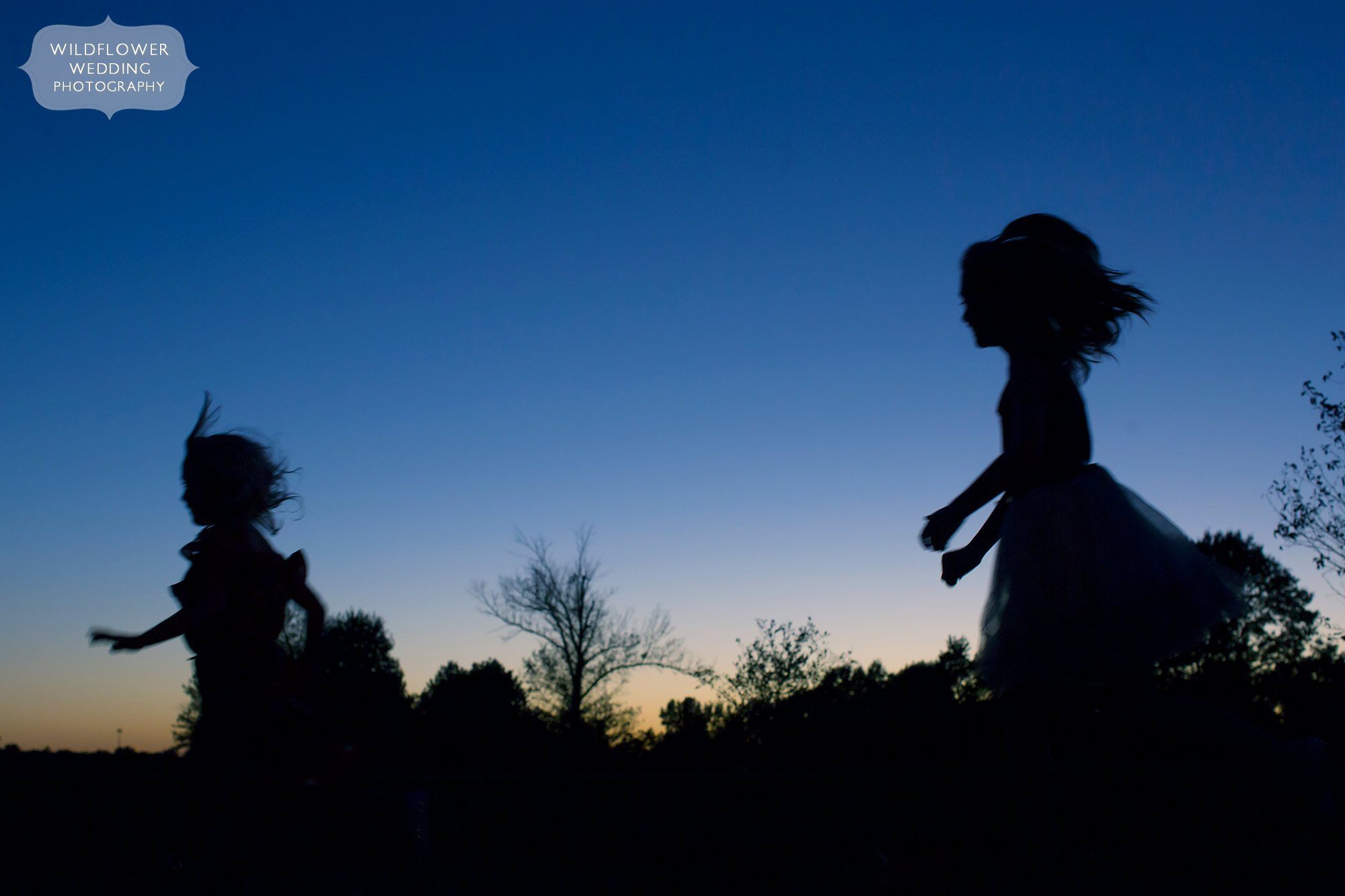 Kids running as silhouettes at Jeff City Country Club in MO.