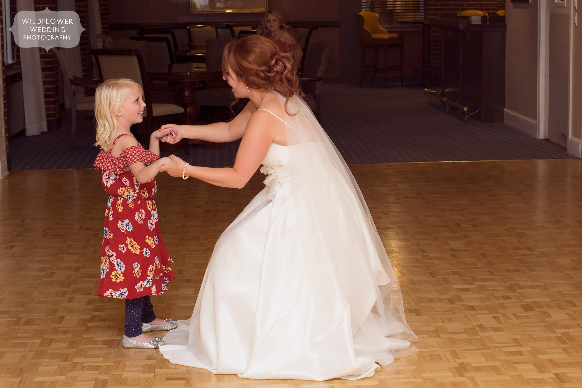 Bride dancing with flower girl at Jeff City Country Club wedding.