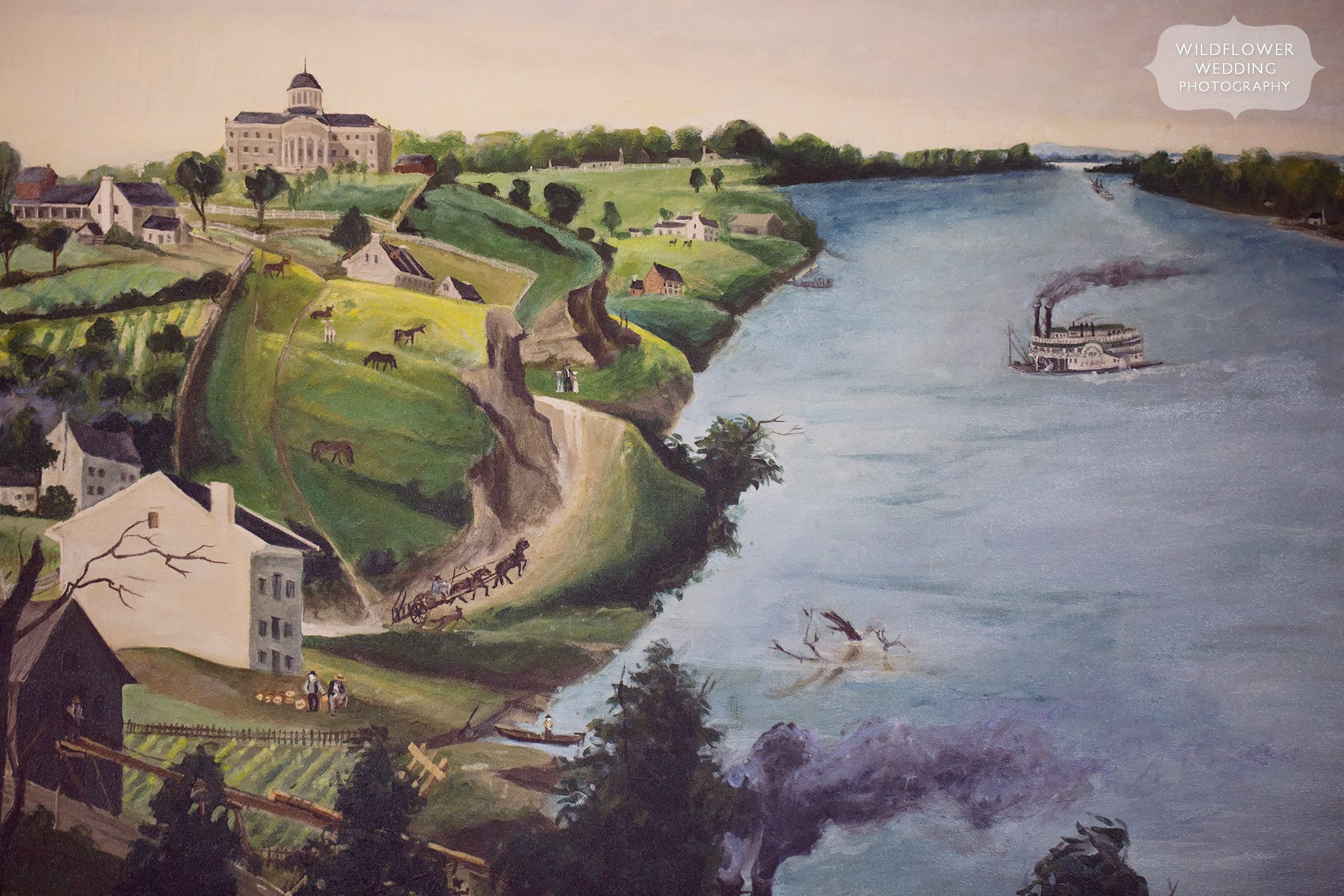 JCCC wedding reception painting of Missouri River and capitol building.