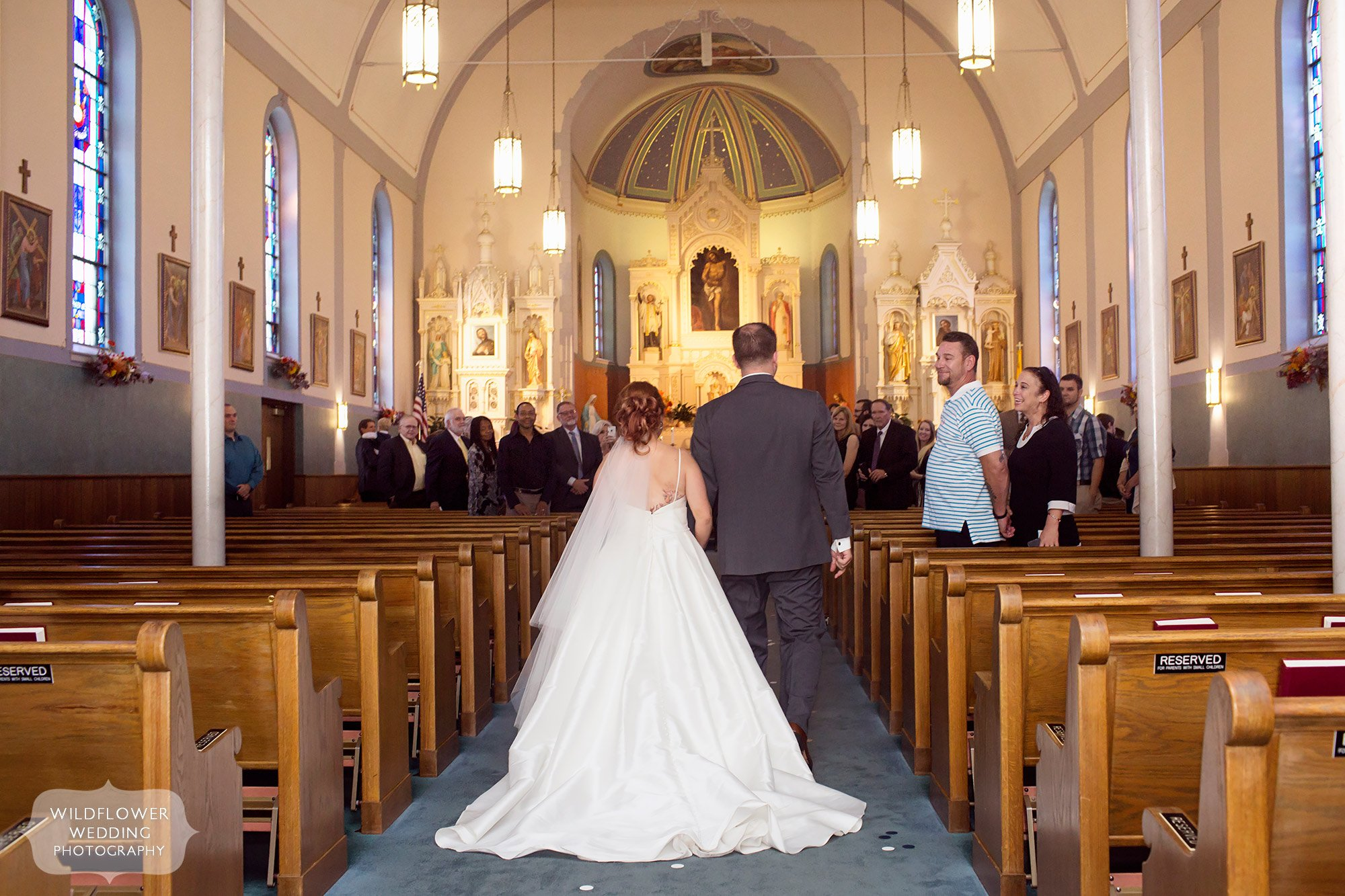 Bride and groom enter the St. Francis Xavier Church for their wedding ceremony in Jeff City.