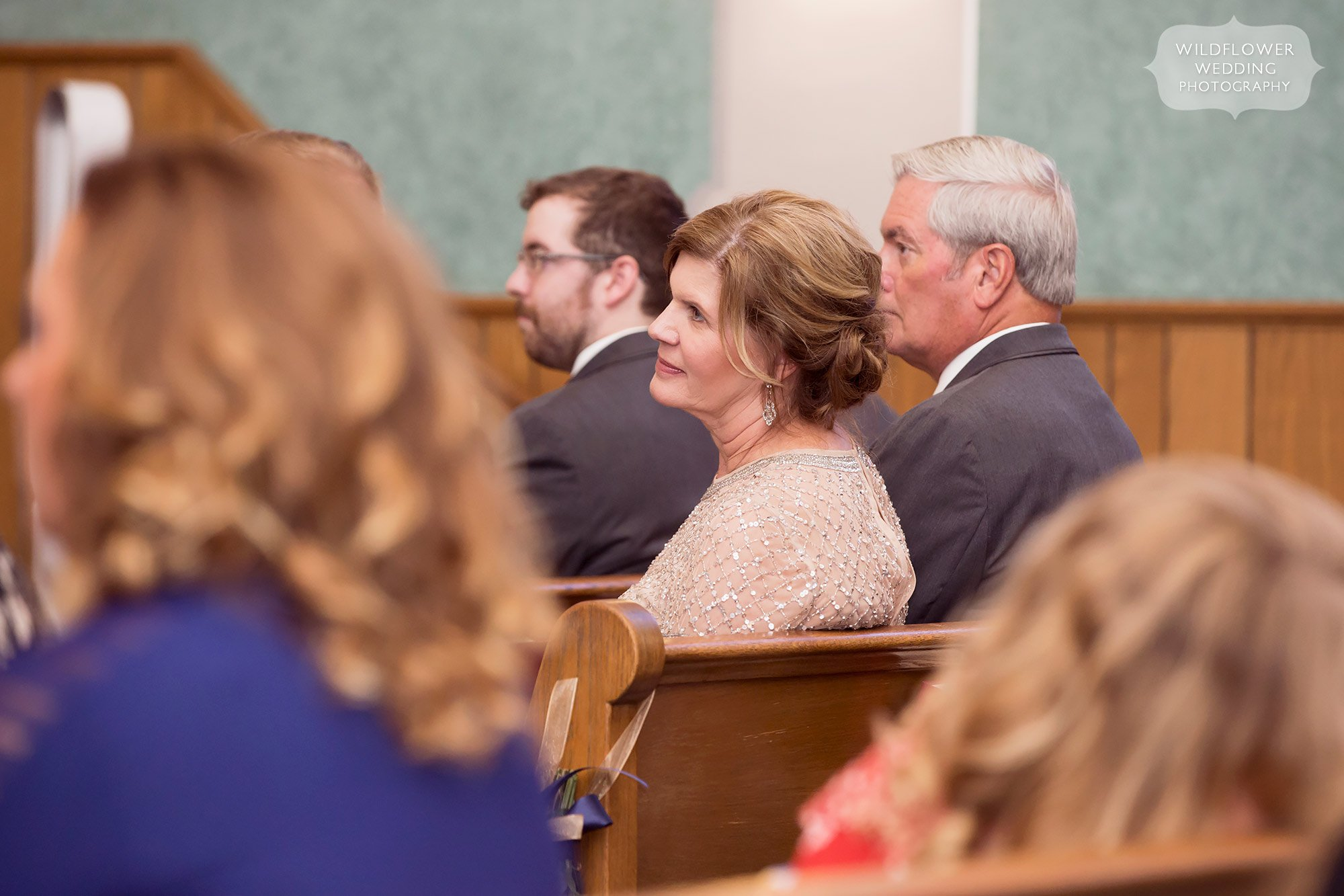 Mother of the groom watching her son tie the knot in Jeff City, MO.