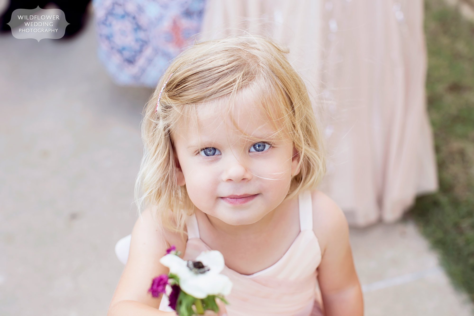 Angelic flower girl with blue eyes at the JCCC in mid-MO.