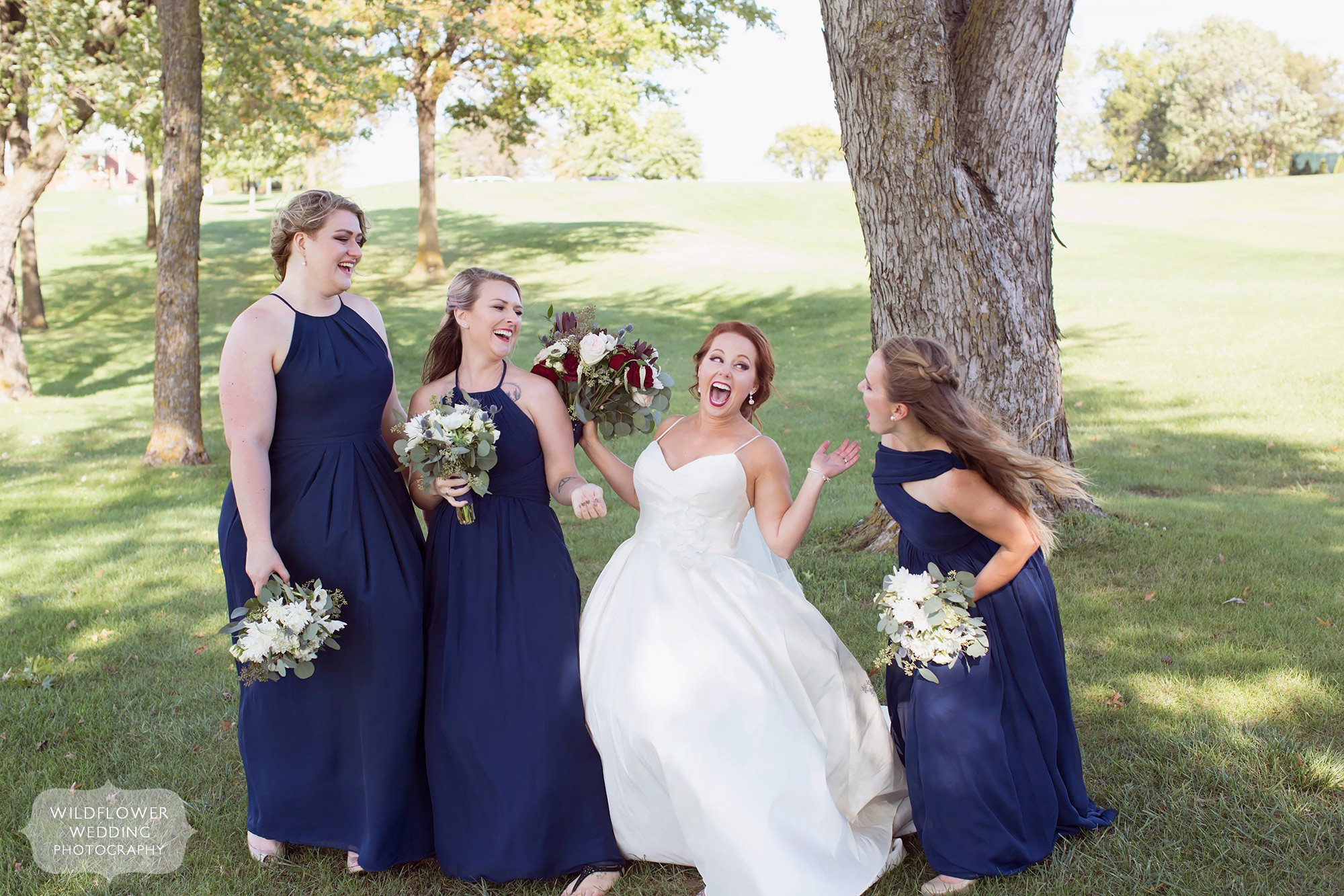 Funny photo of bridesmaids laughing at the Jefferson City Country Club wedding venue in MO.