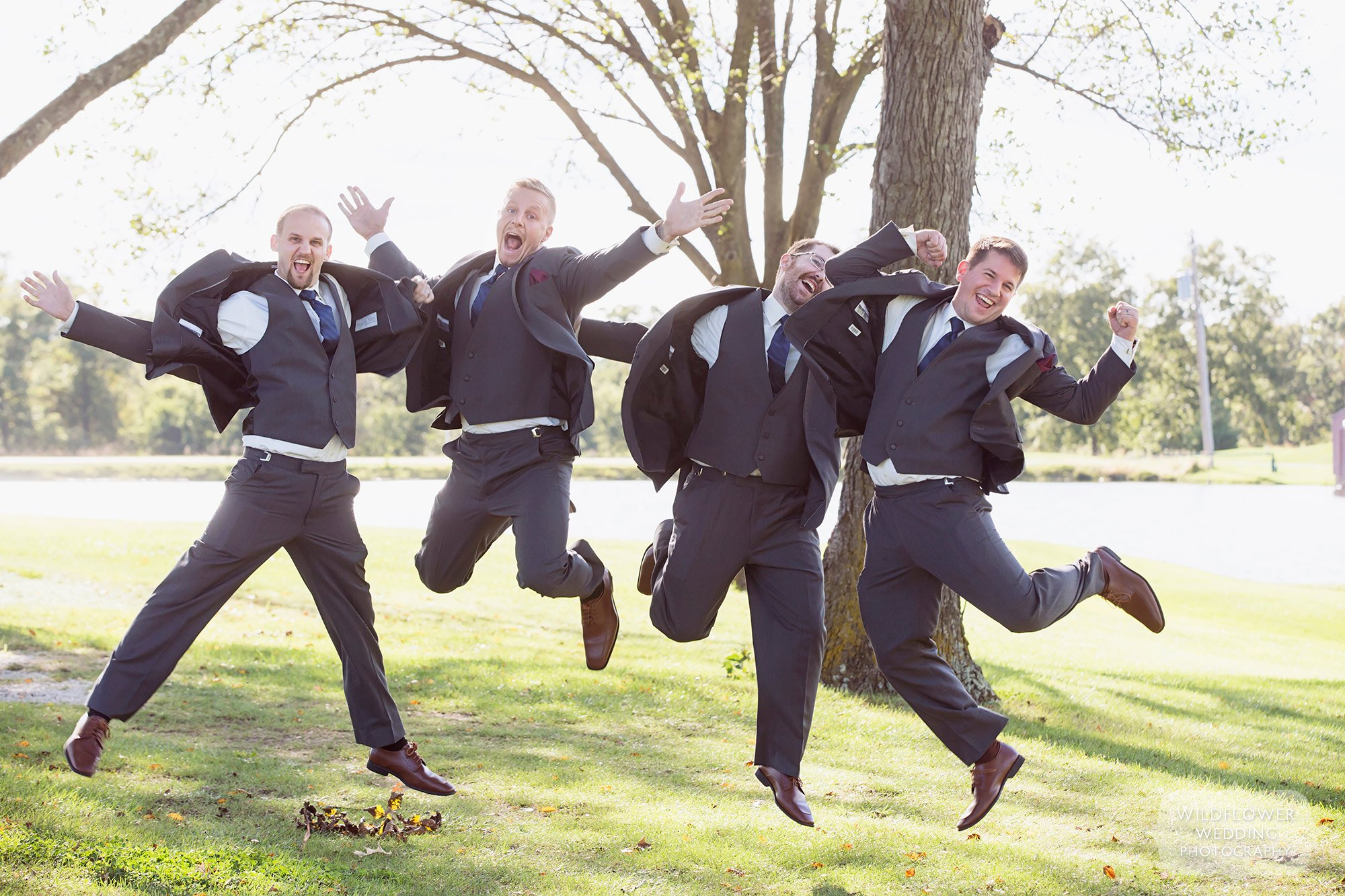 Groomsmen jumping high in the air at the Jefferson City Country Club.