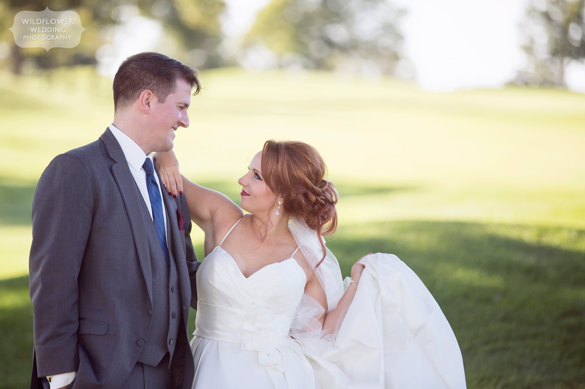 The bride flirts with the groom at this Jefferson City Country Club wedding.