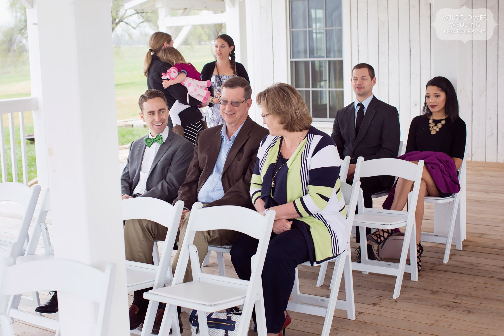 Candid photos of wedding guests before the ceremony in November at the Blue Bell Farm.