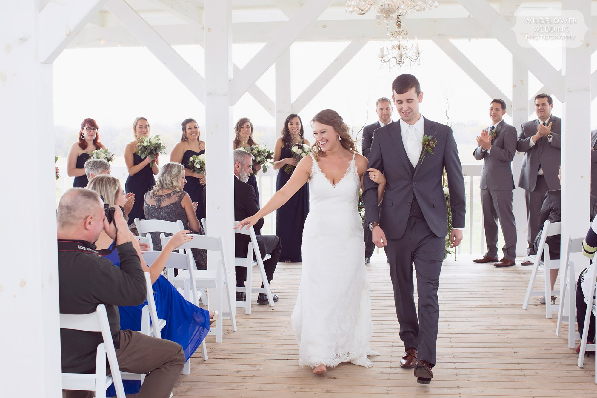 The Blue Bell Farm wedding venue has a bright and ethereal covered deck with surrounding rolling hills.