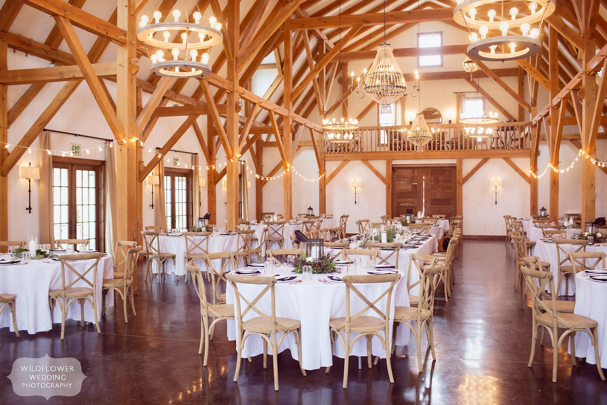 View of the inside of this beautiful timber frame wedding barn venue at the Blue Bell Farm just outside of Columbia, MO.