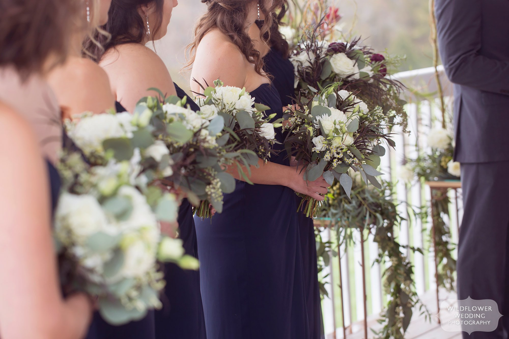 Beautiful green and white cascading wedding bouquets by Kent's on Broadway for this Blue Bell Farm wedding.