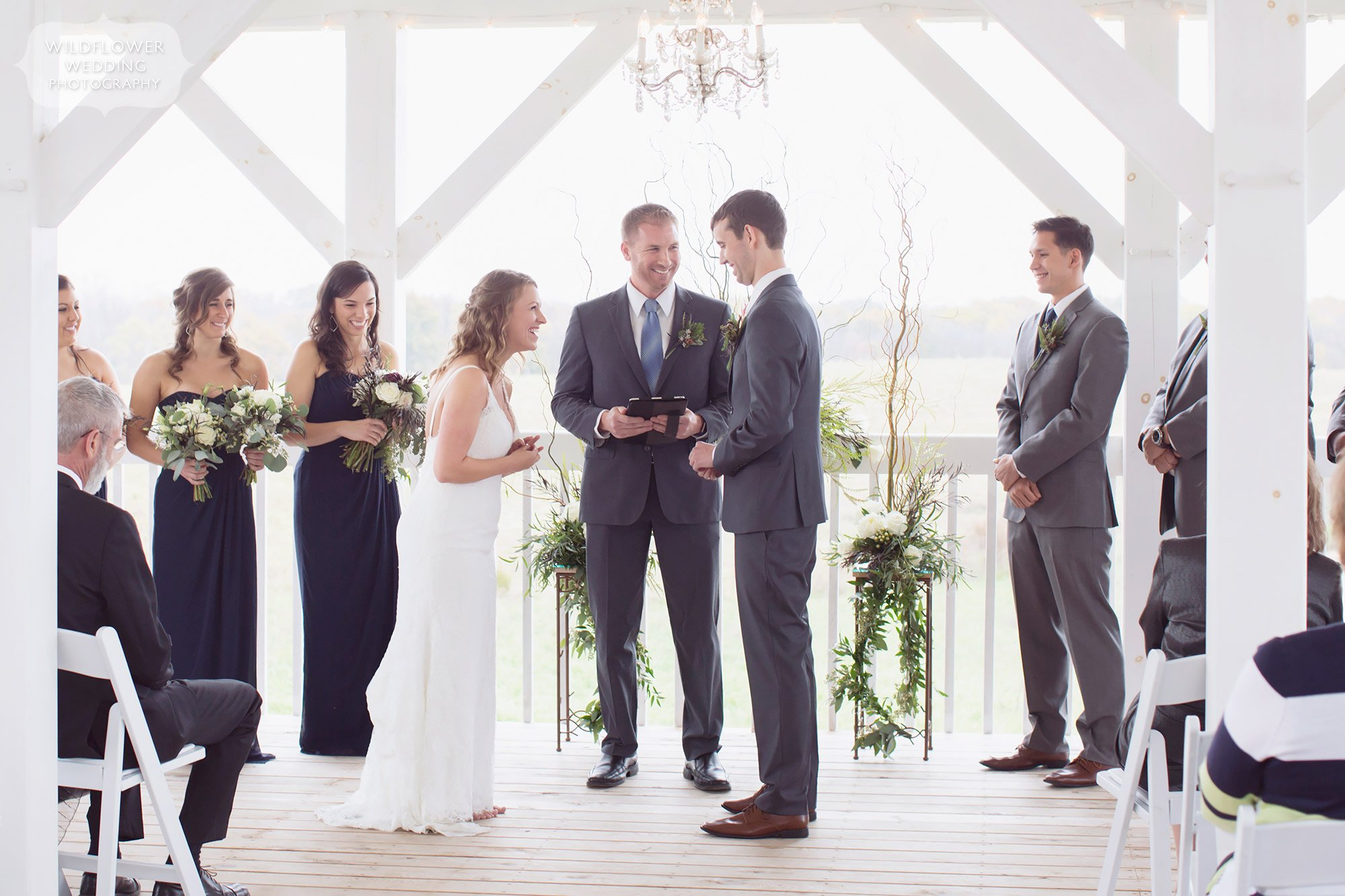 Bride and groom exchange vows on the dreamy scandinavian barn deck at Blue Bell.