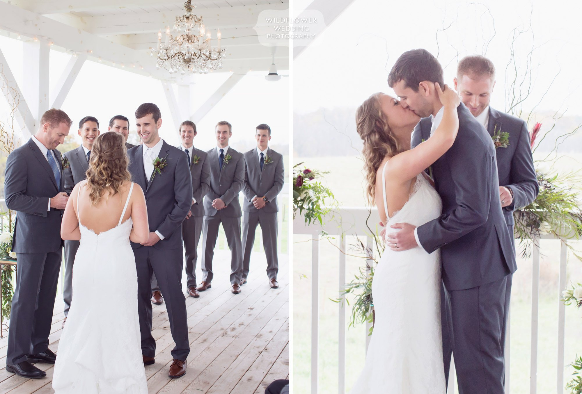 The bride and groom kiss at the end of their ceremony on the Blue Bell Farm deck wedding.