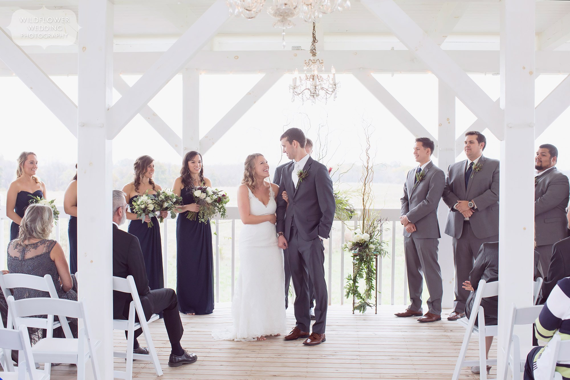 Bride and groom have a romantic wedding ceremony at this norwegian style barn wedding venue near Columbia, MO.