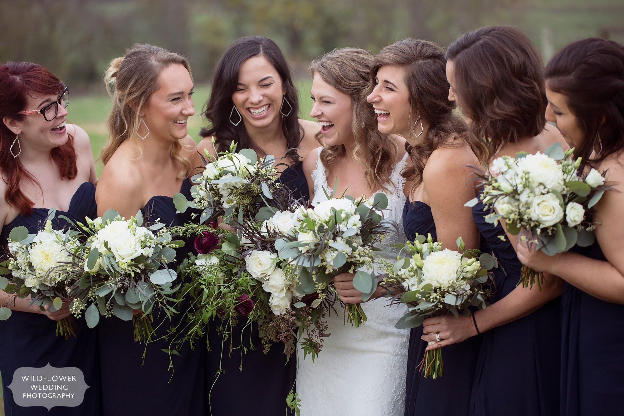 The bride laughs with her bridesmaids at the Blue Bell Farm in Fayette.