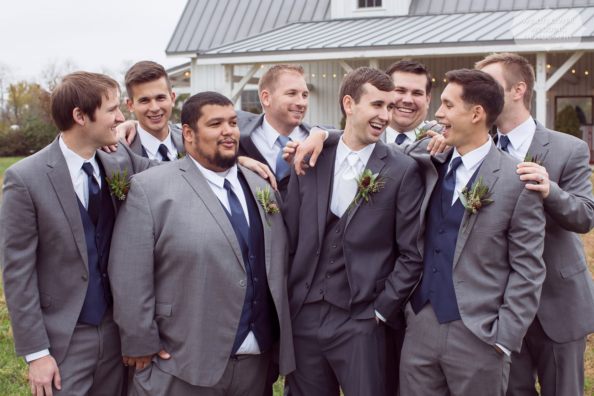 Groom and his groomsmen laugh at the Blue Bell Farm wedding venue.