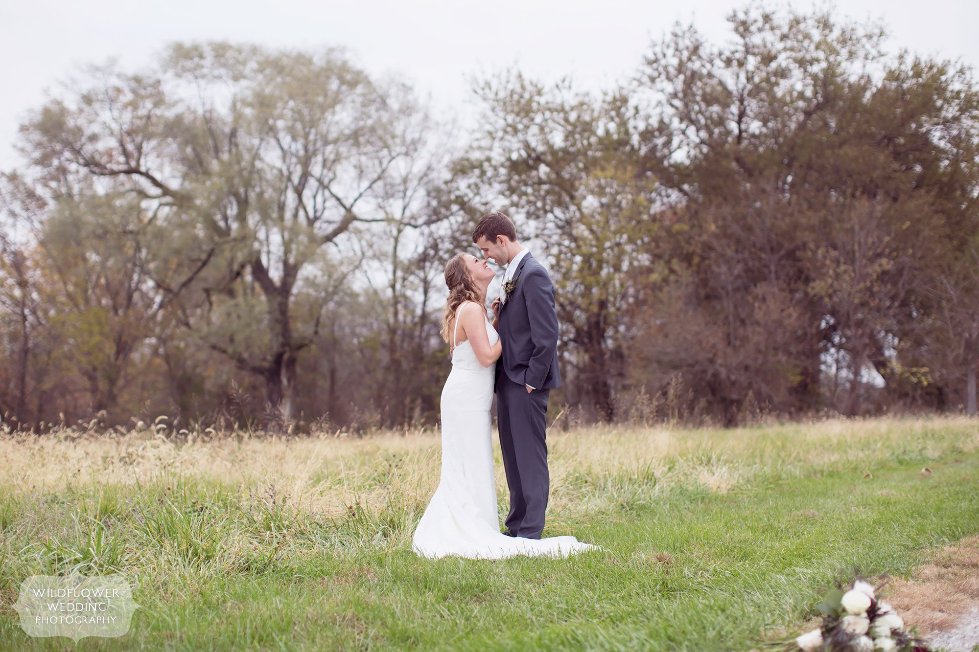 Outdoor field wedding photography of the bride and groom in Fayette, MO.