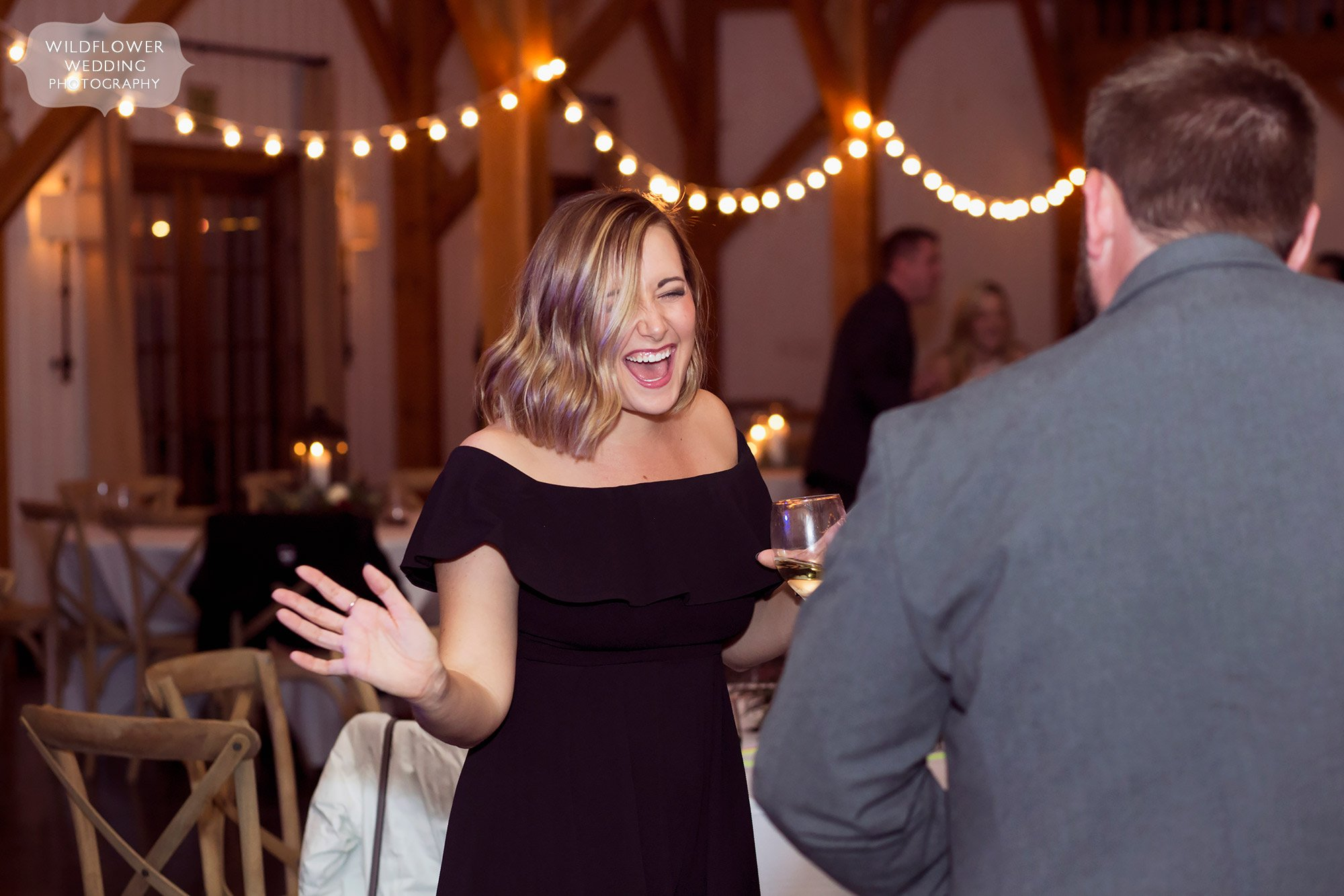 Funny girl laughing on dance floor at Blue Bell Farm.