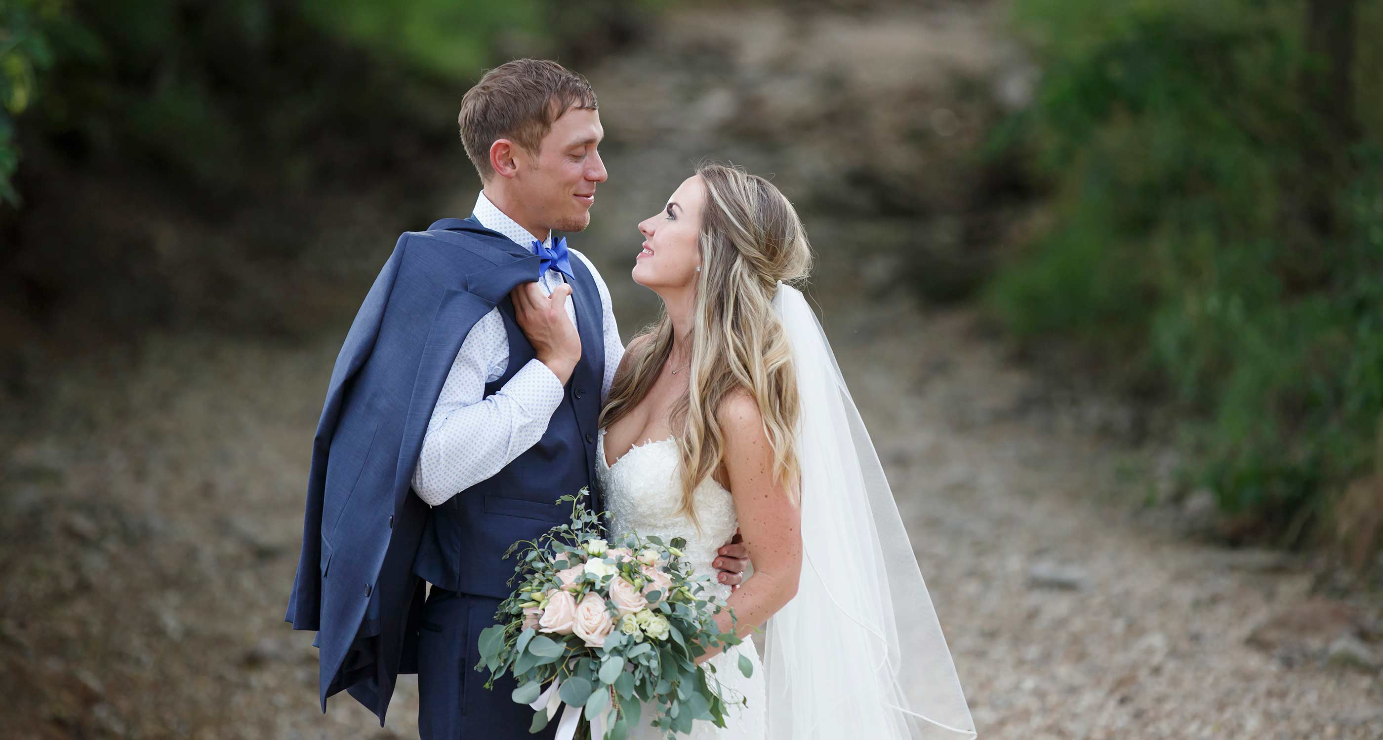bride and groom during a summer wedding at kemper's back 40 just outside of columbia missouri