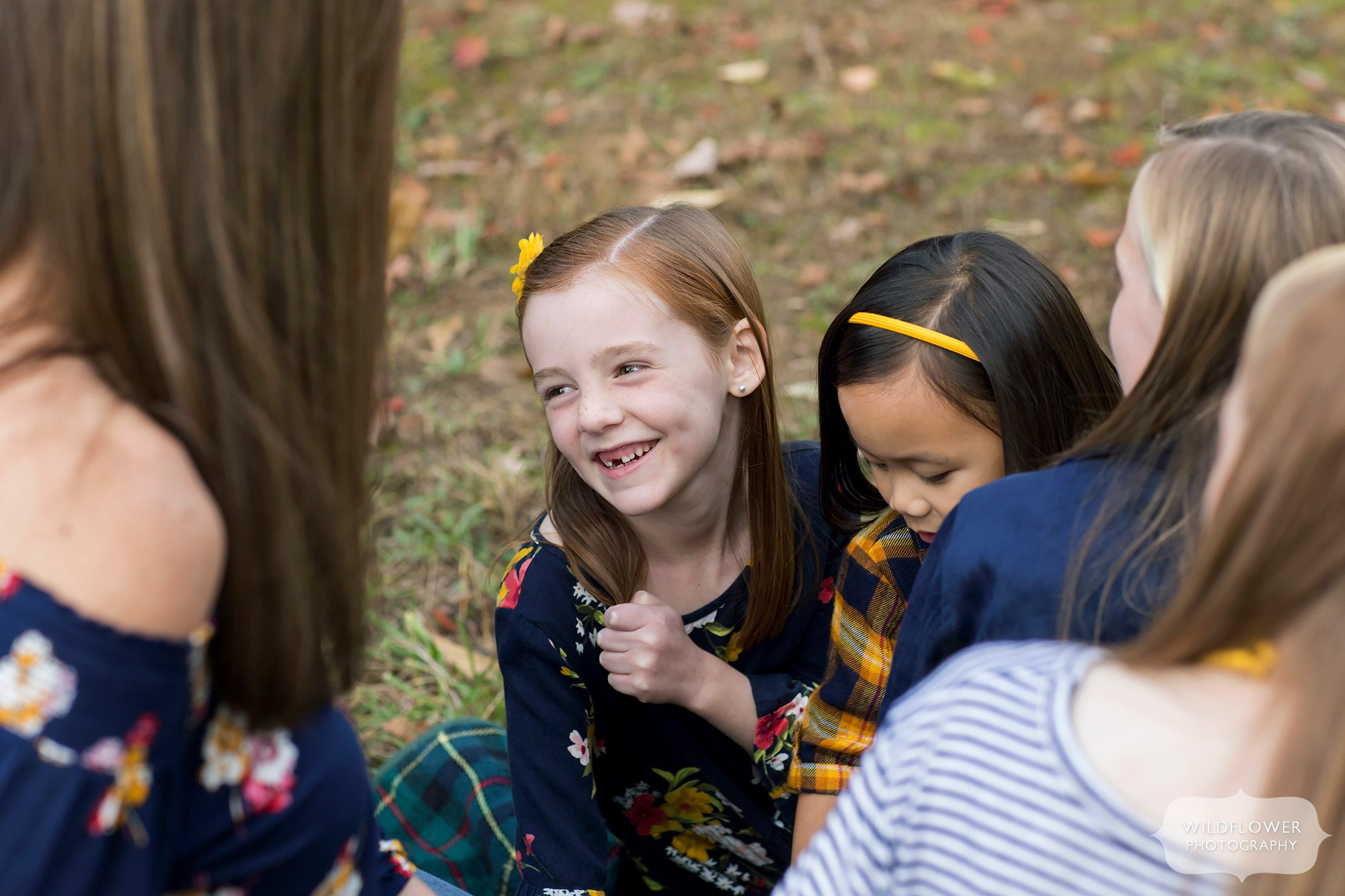 Happy and candid fall family pictures with five year old in Columbia, MO.