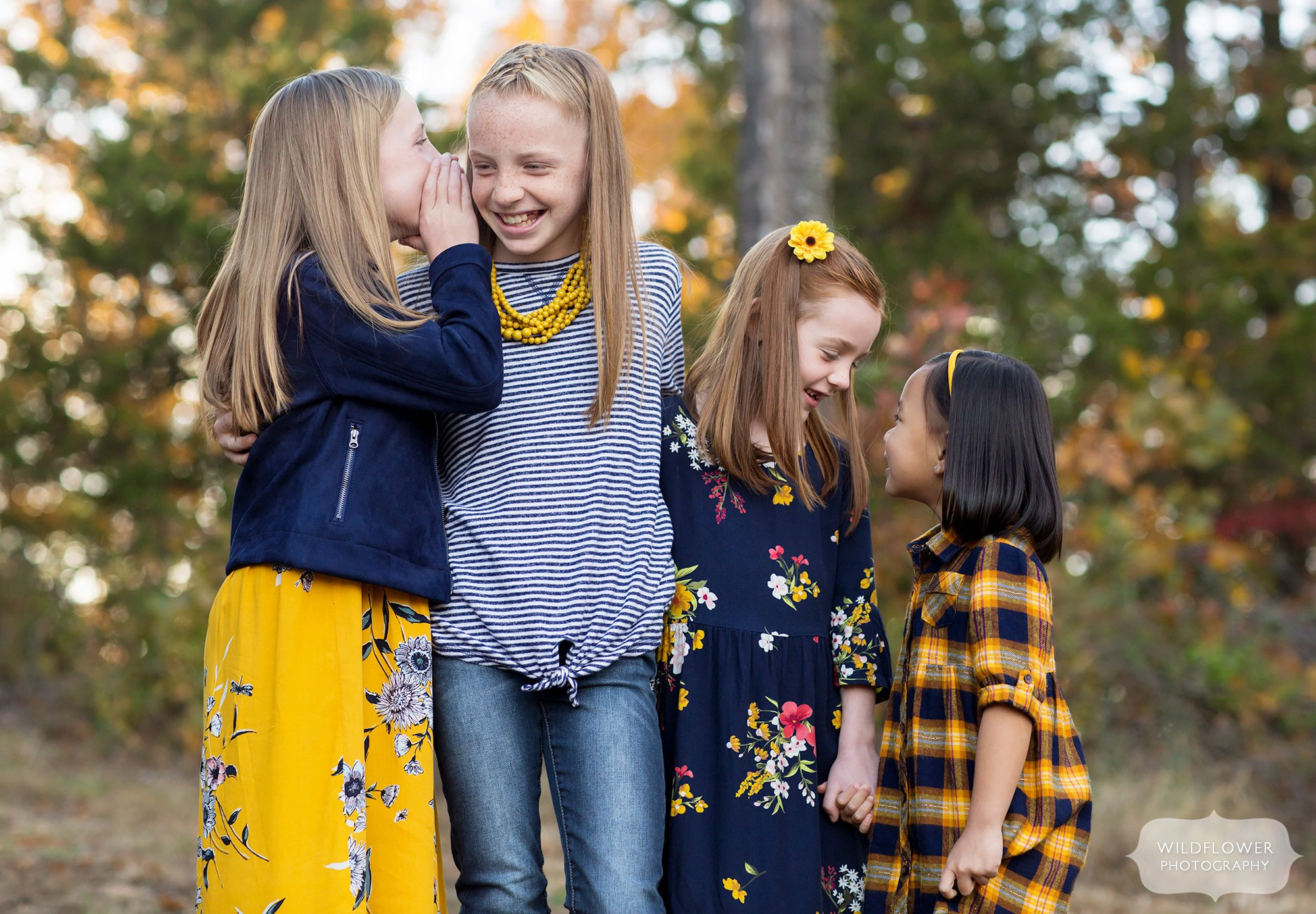 Girls tell secrets during this natural family photography session in Columbia.