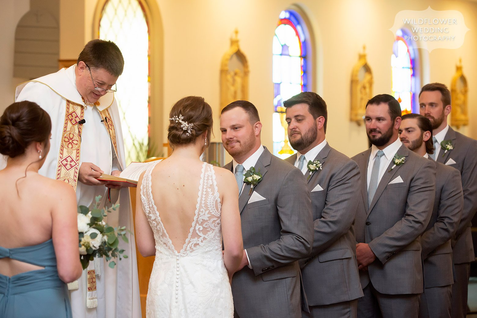 Groom reads vows to bride in church in Mid-MO.