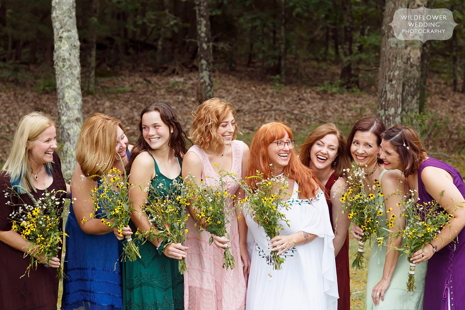 Colorful bridal party with wildflowers in Missouri.