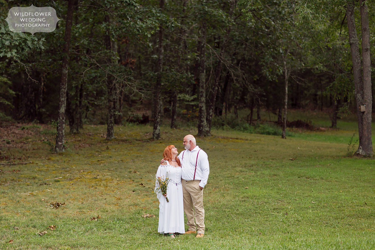 Bride and groom stand in a field in southern Missouri.