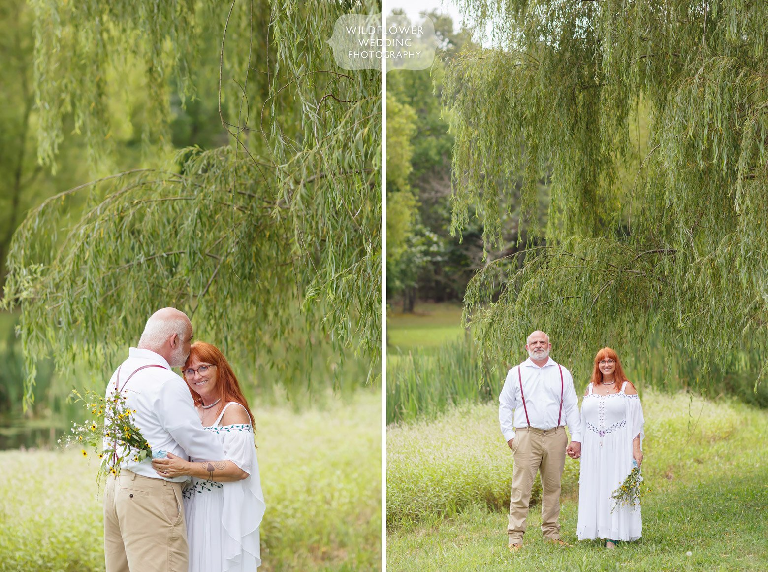 Bride and groom stand under weeping willow tree in Missouri.