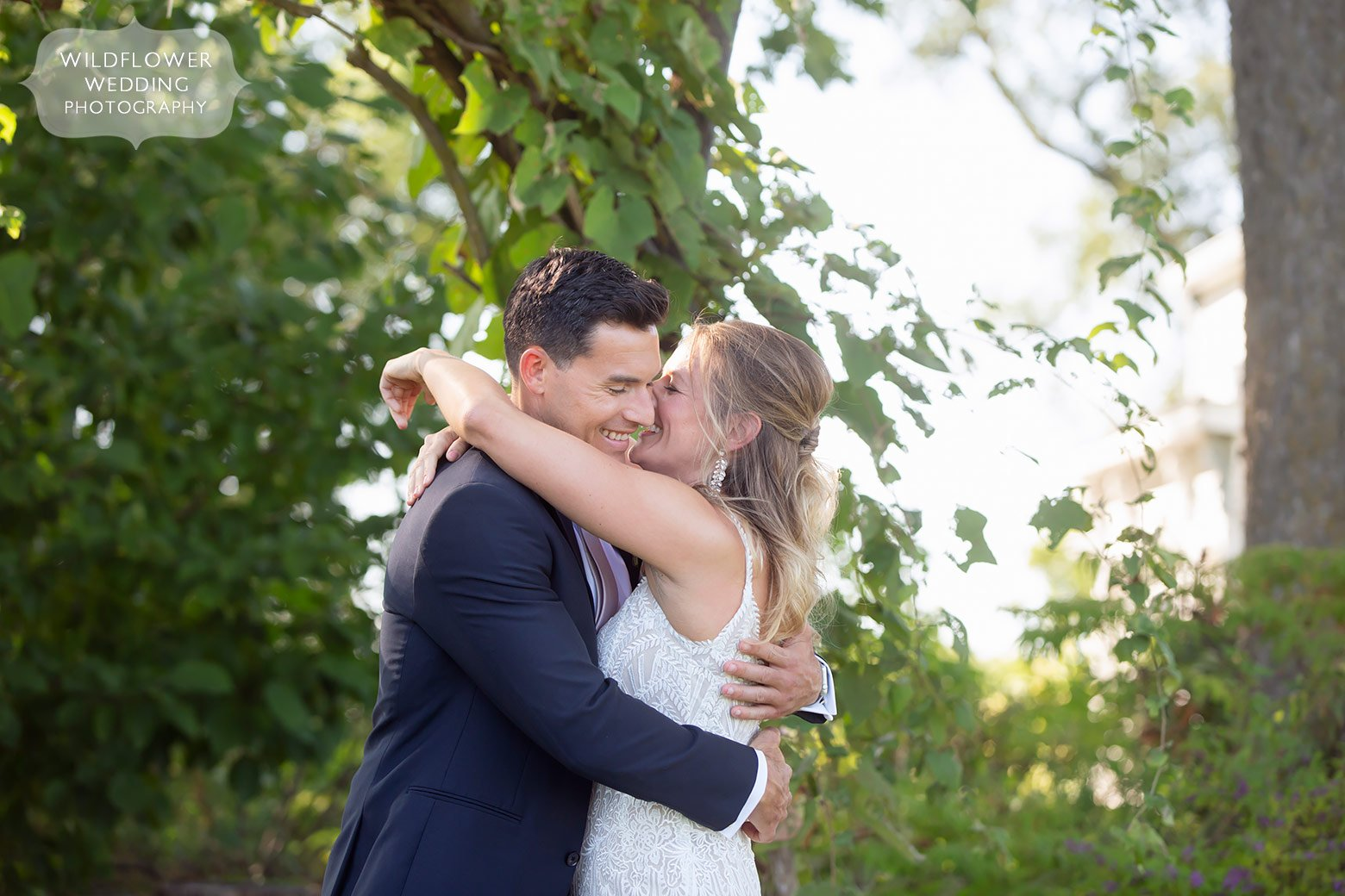 Couple kisses in Fayette before their Mid Missouri barn wedding.