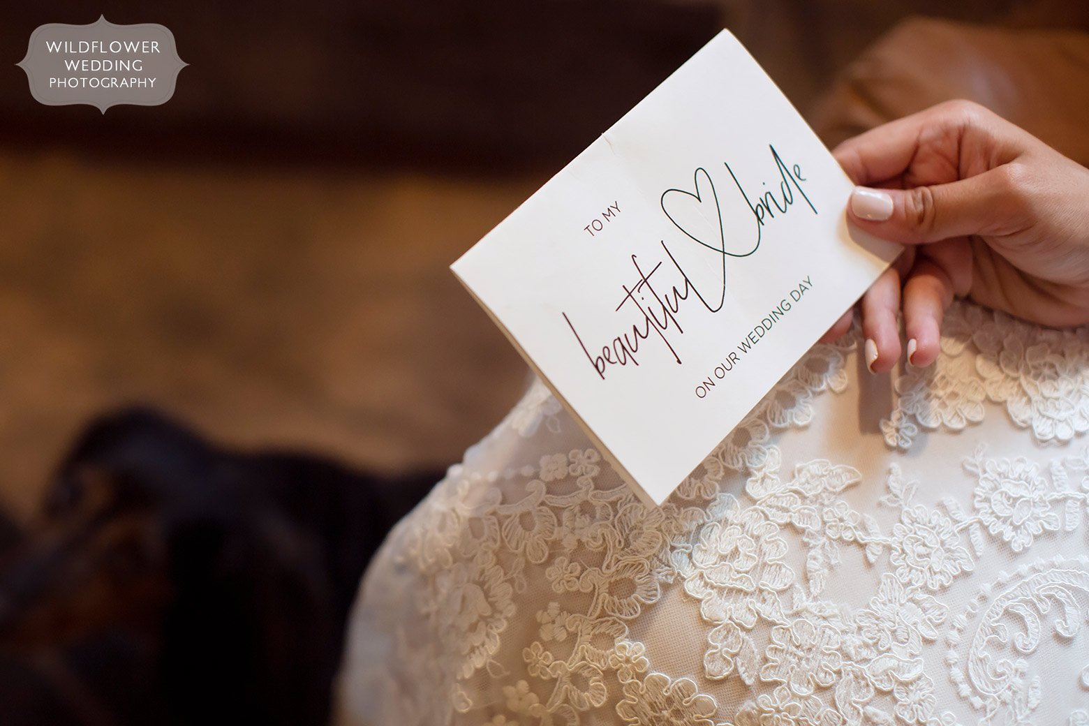 Bride holds a card from the groom before her wedding in Jefferson City.