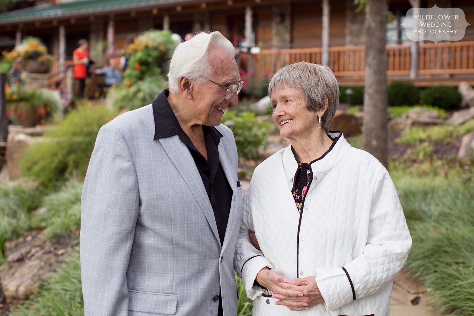 Old couple smiling at each other in Hermann, MO for wedding.