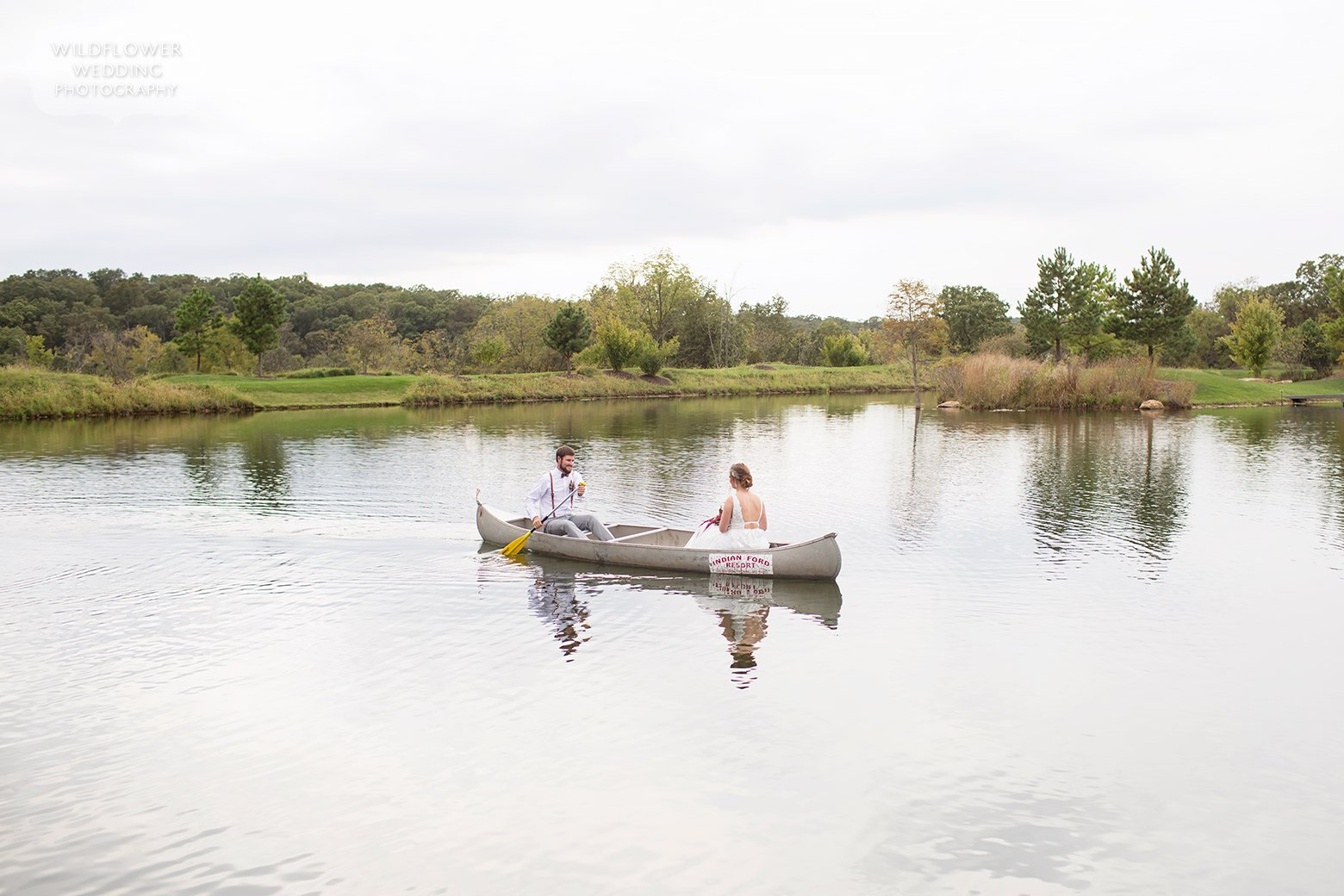 Bride and groom in a canoe in Hermann, MO wedding.