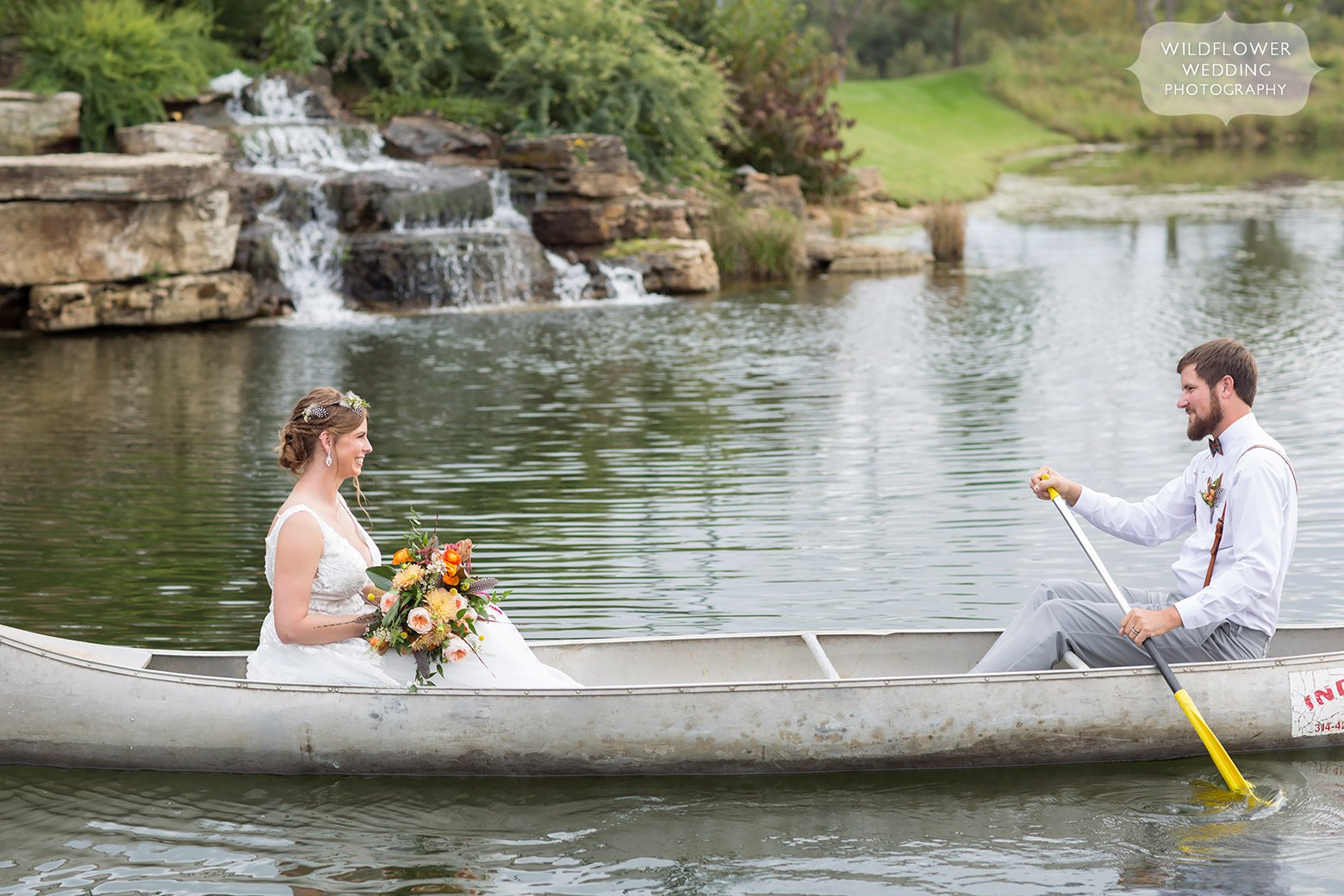 The bride and groom canoeing around a lake near Hermann, MO.
