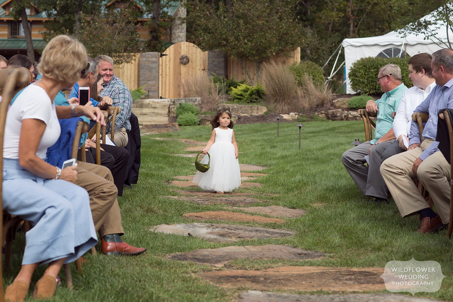 Flower girl enters outdoor ceremony in Hermann, MO.