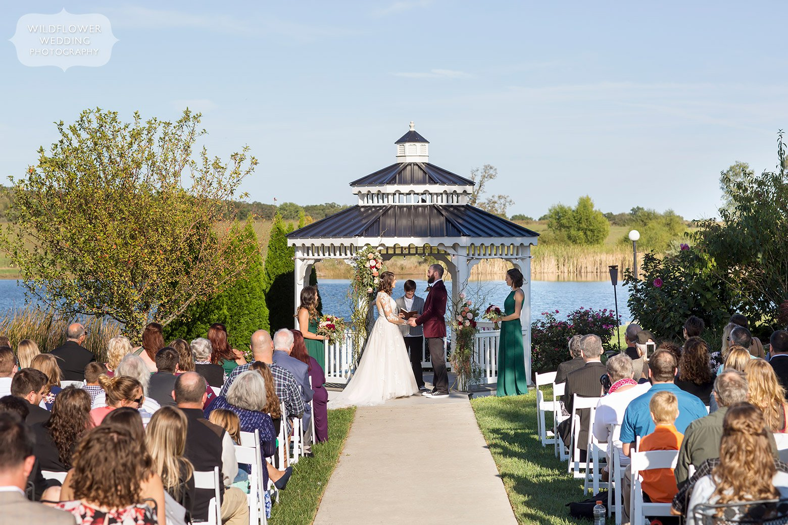 Bride and groom are married under gazebo at Serenity Valley Winery.