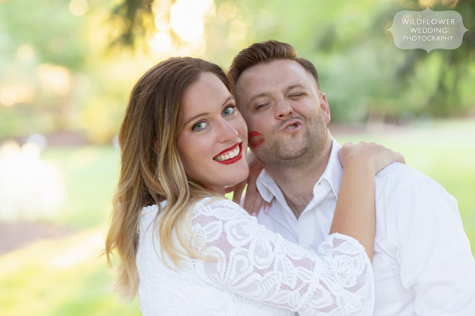 Funny photo of groom's cheek with red lipstick kiss.
