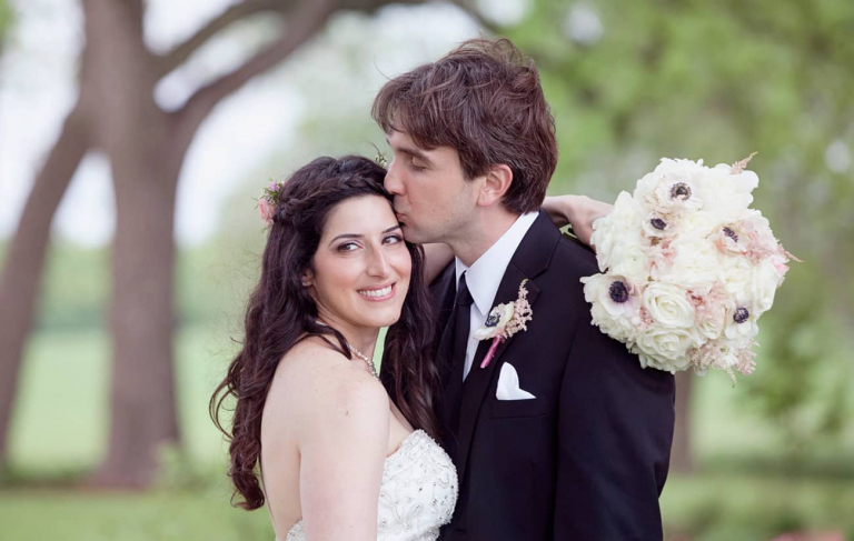 Missouri spring wedding near Columbia at Blue Bell Farm. Documentary wedding photographers in Columbia.