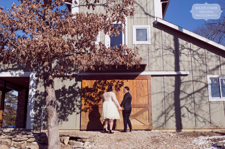 Two women wait outside of the barn for their grand entrance of their same sex winter wedding in Columbia, MO.