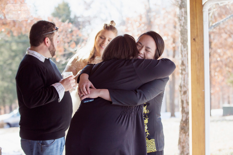 This couple hugs supportive friends after their gay wedding ceremony in mid-MO.